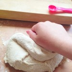 one hand kneading dough