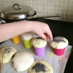 putting poppyseeds on bread dough