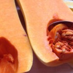 scrape out the squash seeds using a teaspoon
